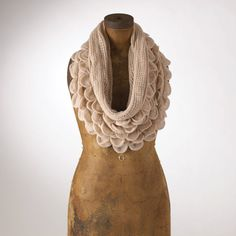 Infinity scarf by fennco. Hmmm...wonder if there is a similar pattern I could knit. Must check Ravelry.