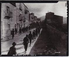 Troops march into Serradifalco, Sicily (SC-179673). NARA.