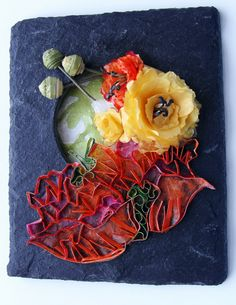 Another small quilled piece on natural slate.