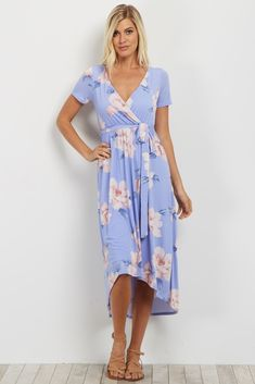 Floral print wrap dress. Hi-low hemline. Sash tie. Short sleeves. Double lined to prevent sheerness. This style was created to be worn before, during, and after pregnancy.