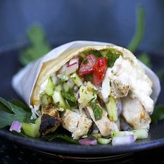 Spicy Chicken Shawarma: A Middle Eastern wrap of tender spicy grilled chicken, cucumber salad, and lemony tahini sauce