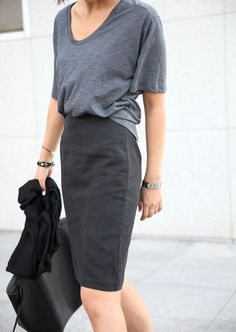 Photo via: Death by Elocution Work clothes don't necessarily have to be boring. Don't believe us? Check out this ultra-chic grey-on-grey office look that consist of a slouchy tee and a fitted pencil s