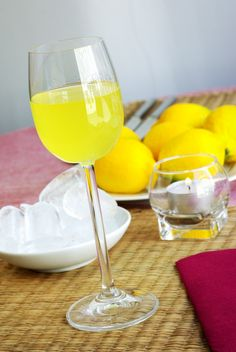 Limoncello with lemons, a famous digestivo of Italy