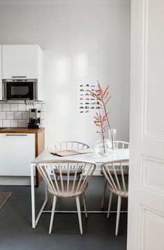 A STOCKHOLM HOME WITH A FEW TOUCHES OF RED | THE STYLE FILES