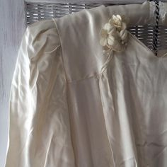 Shoulder detail of my Nan's wedding dress from the 1940's- the most beautiful heavy silk, the colour of clotted cream. So blessed to have this dress and it's the inspiration for my new GOTHIC FORTIES dress designs #inspiration #heirloom #treasure #Bridal #bespoke #wedding #vintage #silk #flowers #cream #1940s