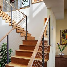 Looking for Staircase Design Inspiration? Check out our photo gallery of Modern Stair Railing Ideas. Wooden Staircase Railing, Cable Stair Railing, Modern Stair Railing, Stair Railing Design, Modern Stairs, Railing Ideas, Banisters, Bannister Ideas, Banister Remodel
