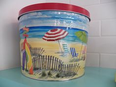 Our gourmet popcorn is a sweet, savory, and or chocolatey experience that people won't soon forget. Pictured, popcorn tins for beach days 🐙 Popcorn Store, Popcorn Tins, Best Popcorn, Flavored Popcorn, Gourmet Popcorn, Movie Theater Popcorn, Popcorn Company, Salt Water Taffy, Third Street