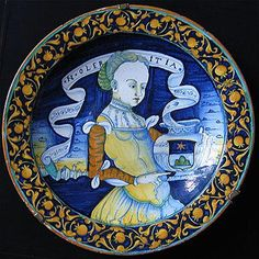 Plate with Woman Holding a Vase with Coat of Arms of Chigi 1560s Castelli. Orazio Pompei