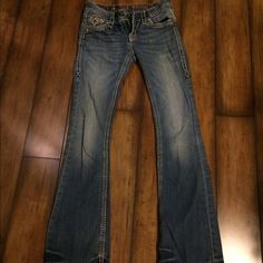 Rock Revival Jeans size 25 Rock Revival Jeans size 25 with some slight damage on each leg at the bottom. Rock Revival Pants Boot Cut & Flare