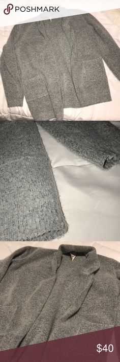 Grey sweater Light grey sweater, pockets on the front, long sleeve, beautiful neck, adjustable to however you want to style it. Detail in the bottom. Warm and fuzzy, soft material, not itchy. It is a size Large but fits like a medium. Sweaters Crew & Scoop Necks