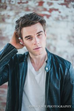Phillip Maccabee. He is a 24 year old low ranking Imperium who was adopted when he was 4 after his mother went missing. He's been determined to figure out more about his past for the last couple years, and is finally starting to get somewhere with his investigation. {FC: Nathaniel Buzolic}