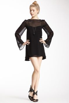 """Bindi Dress in black by Love & Lemons $150 - $49 @HauteLook. - Crew neck - Long bell sleeves - Sheer construction - Lined under-dress with spaghetti straps - Approx. 31"""" length Model's stats: - Height: 5'11"""" - Bust: 32"""" - Waist: 25"""" - Hips: 35"""" Model is wearing size S. Dry clean. Shell: 100% polyester. Lining: 100% polyester."""