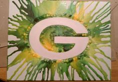 crayons arranged in a G, then melted. so awesome!