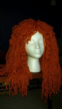 Merida's from Brave Halloween yarn wig. I used a net wig cap, crocheted some large curls and un-twisted some of the yarn to create frizzy curls