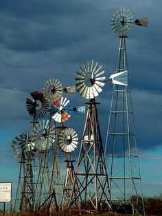 Cluster of wind pumps near Montague, Texas. Tilting At Windmills, Old Windmills, Blowin' In The Wind, Wind Of Change, Farm Windmill, Windmill Diy, Vive Le Vent, Weather Vanes, Weather Wind