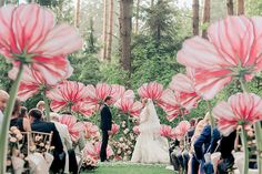 Oversized paper flowers transform your wedding venue into an enchanted garden.