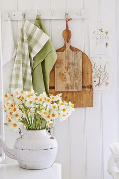 Spring Green with Vintage Wooden Kitchen Boards, Green Check Towel and White Vase of Narcissus