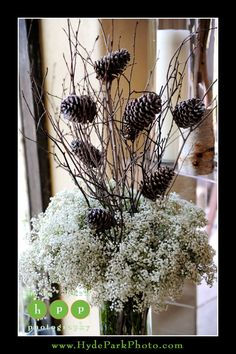 Pinecones and baby's breath is a nice way to bring winter to the floral and decor. Wedding at The Barr Mansion. Photos by Austin wedding photographers, Hyde Park Photography, located in Austin, Texas. #ATXweddings  http://www.HydeParkPhoto.com