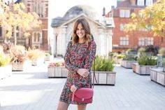 Kim from @LoveClothBlog wears our Medium Pushlock in Berry Red.