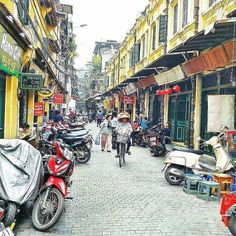 One of the most vibrant streets in Hanoi's Old Quarter Ta Hien is a focal point for the city's nightlife scene. Join the crowds of fellow travelers and take in the bars restaurants and souvenir shops that this historic street has become known for. Photo by @theshortjourneys. #agodalens