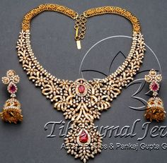 Very rich broad and huge diamond bridal design necklace from Tibarumal Jewels -A Ram Bharos & Pankaj Gupta Group, Hyderabad. Floral clasps and curved diamonds intricate necklace festooned with rubies studded class Ruby Jewelry, India Jewelry, Stone Jewelry, Diamond Jewelry, Diamond Jhumkas, Gold Jewelry, Diamond Pendant, Indian Jewellery Design, Jewelry Design