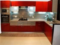 Very interesting modern kitchen! Surprisingly this much red looks very nice :)