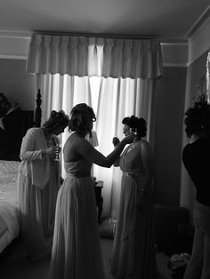 The bridesmaids enjoying a glass of bubbly whilst getting ready