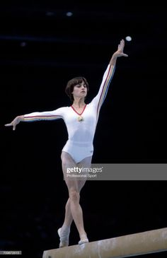 Romanian gymnast Nadia Comaneci pictured in action to win the gold medal on the balance beam during competition in the women's artistic team. Elite Gymnastics, Acrobatic Gymnastics, Gymnastics Photos, Artistic Gymnastics, Olympic Gymnastics, Olympic Sports, Olympic Games, Nadia Comaneci Perfect 10, Famous Gymnasts