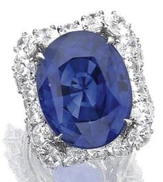 Attractive Sapphire and diamond ring, Alexandre Reza The oval sapphire weighing 28.63 carats, to a frame of similarly cut diamonds, mounted in platinum, size 53, signed A. Reza, French assay and...