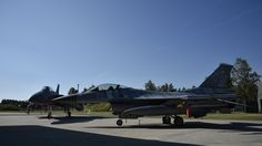 United States Air Force F-15C aircraft next to a Polish F-16 fighter at Siauliai Air Base, Lithuania, during the Baltic Air Policing handover ceremony. Photo by Antanas Gedrimas 30 AUG 2017 SIAULIAI, Lithuania - The United States Air Force took over the lead of NATO's Baltic Air Policing mission at Šiauliai Air Base, Lithuania, from the Polish Air Force.