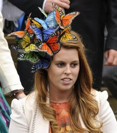 Philip Treacy Butterfly hat.  Smiling and wondering if I should be scared that so many butterflys are attacking her head?