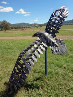 'Wedge-tailed Eagle' sculpture by Will Carr;  A life-sized sculpture made from old plough points.