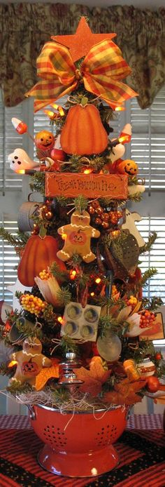 An Autumn Holiday Tree complete with Halloween and Thanksgiving decorations. Halloween Trees, Holidays Halloween, Halloween Pumpkins, Halloween Crafts, Halloween Tree Decorations, Halloween Kitchen Decor, Fall Kitchen Decor, Halloween Stuff, Happy Halloween