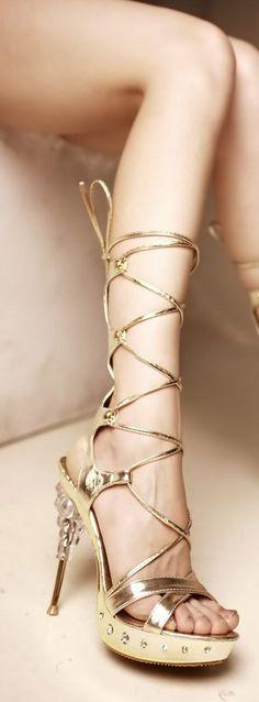 Love this ! golden tie up high heel shoe