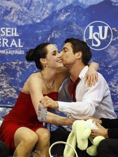 """""""love is...""""Tessa Virtue and Scott Moir of Canada react after they won the Champion title of Ice Dance at the ISU 2012 World Figure Skating Championships in Nice-France."""