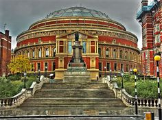 "Royal Albert Hall - partly a memorial to Queen Victoria's husband, but only in name. He had been working on the ""Hall of Arts & Sciences"" for many years preceding his death. The yearly Promenade Concerts (Proms) have been broadcast from here since 1942. On the 15th September 1963: The Beatles & The Rolling Stones played the same gig here - the only time that occurred during their careers. SW7, South Kensington Tube. By nick.garrod on Flickr, 2006."