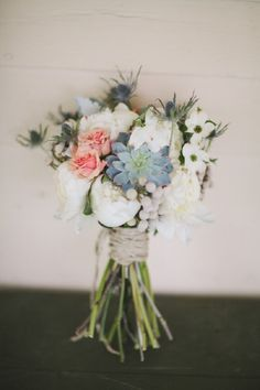 Lovely wildflower bouquet via http://theeverylastdetail.com/rustic-peach-green-farm-wedding/