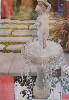 """Sparkle Plenty for a Garden Party ~ Chandelier crystals overflow & drip from a sparkling fountain bowl into a mirrored """"pool"""" below. **I'd use an acrylic mirror for the pool and fill the bowl with clear glass floral gems. (From my own clipping collection - sorry, but I have no record of original source - please advise me if you know, thanks.)"""