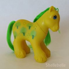 Colombian yellow Daddy Apple Delight with bright green hair and trees that are green and light green - want!