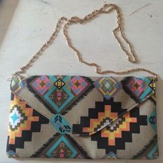 Aztec print purse with gold chain strap So cute! Canvas exterior, silky lining. Tiny smudge inside that is barely noticeable (can see it in second photo, in right corner). Boutique Bags