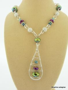 Snow shoe Sparklers necklace.  It's too busy though.  Lose the beads around the neck and instead hang it on a nice chain.