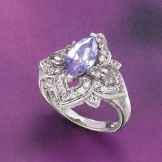 Enchantment absolutely sparkles in this arrangement of lavender and diamond-bright CZs, marquise cut for brilliance in a charming setting of sterling silver.