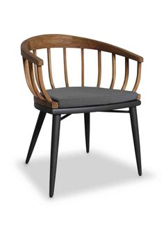 The Puerto Arm Chair has a teak wood frame with an aluminum base and upholstered seat.