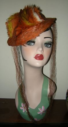 VINTAGE 1940's Orange FEATHER TILT Hat with Brown Tulle and Elastic from vintagejewelsandjunk on Ruby Lane