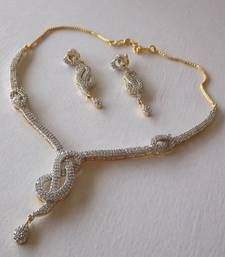 Buy Golden and White Delicate American DIamond Necklace Set with Earrings necklace-set online