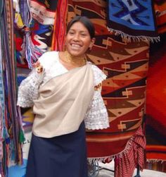 Ecuador-tapestry by GaryAScott, via Flickr  ...This girl is dressed in the traditional costume of Otavalo.