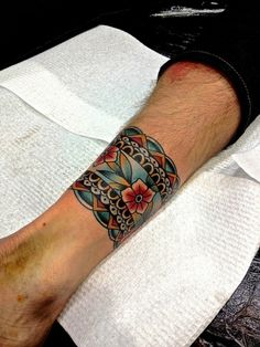 Don't normally like traditional tattoos, but this band is gorgeous! Definitely something to think about | ink-its-art: Kirk Jones