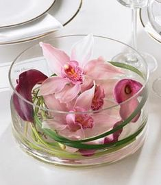 Floating Centerpiece with Cymbidium orchids, calla and lily grass