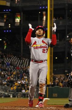 Jhonny Peralta celebrates after hitting a two run home run in the ninth inning against the Pittsburgh Pirates. Cards won the game 6-1.  4-05-14