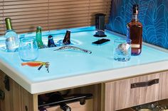 The Tommy Bahama Travel Trailer has a built-in bar which lights up to a beautiful ocean blue. Airstream Travel Trailers, Receiver Hitch, Built In Bar, Splash Page, Beautiful Ocean, Rv Travel, Rv Life, Tommy Bahama, Lights